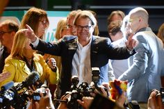 President of Catalonia Artur Mas celebrates as the Catalanist coalition 'Junts Pel Si' (Together for the Yes) reportedly look close to winning the regional elections held in Catalonia on September 27, 2015 in Barcelona, Catalonia.