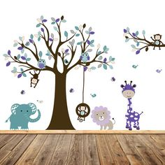 This multicolored jungle themed vinyl wall decal mural,in teal blue, purple, lilac, grey, and browns,is sure to add an explosion of color to your