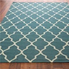 Teal rug, would go so well with gray couch + bright accents.