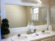 DIY - Frame your dull bathroom mirror! Love it, but I think I'd paint it dark brown