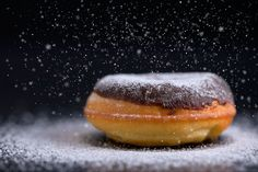 Happy meal - Sprinkling sugar on delicious donut topped with chocolate.