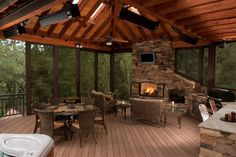 A full outdoor kitchen with an oversized rock fireplace creates a family gathering space and gives our clients the entertainment element while our fixed Outdoor Rooms, Outdoor Living, Outdoor Decor, Future House, My House, Rock Fireplaces, Covered Decks, Outside Living, Decks And Porches