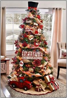 Get plenty of inspiration with these beautiful Christmas tree ideas. From rustic to farmhouse Christmas trees, there are ideas for every style of decor. Burlap Christmas Tree, Beautiful Christmas Trees, Christmas Tree Themes, Noel Christmas, Xmas Decorations, Simple Christmas, White Christmas, Diy Christmas Tree Topper, Country Christmas Trees