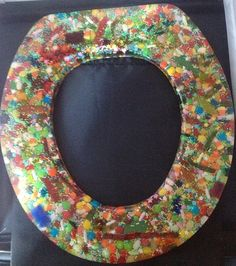 This is one time when you want to see sprinkles on the toilet seat. It's a resin toilet seat with candy embedded within. MnMs, gummi bears, rainbow sprinkles and more give a certain whimsy to the bathroom. No- I don't have one- this smile will set you back $300!