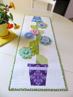 """Cute table runner based on our """"Poison Ivy"""" pattern using our """"LOL"""" fabric for Moda. In stores now! For pattern and """"Makin it Cute"""" flowers check out our website meandmysisterdesigns.comr"""