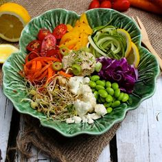 """"""" Raw baba rainbow salad made with spiraled zucchini, carrot, red cabbage, edamame, cauliflower, bean sprouts, alfalfa sprouts, cherry tomatoes, yellow bell pepper and is topped with..."""