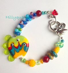 Happy monster lampwork bracelet by Hillyquack2013 on Etsy