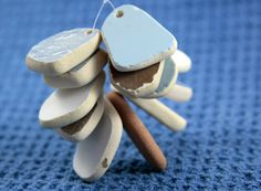 Genuine Beach Sea Pottery Shards Top Drilled jewelry quality 12 pcs. $11.00, via Etsy.