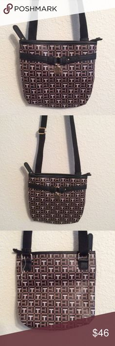 🎁TOMMI HILFIGER CROSSBODY OR SHOULDER BAG. NWOT 🎁BRAND NEW-TOMMI HILFIGER SHOULDER OR CROSSBODY HANDBAG. IT HAS AN ADJUSTABLE STRAP TO CHANGE THE SIZES OF THE STRAP. SIGNATURE LOGO PURSE THAT IS SO ON TREND AND STYLISH. BLACK STRAP AND TRIM AND BROWNS. GOLD LOGO EMBLEM ON THE FRONT. NICE POUCH AND ZIPPER COMPARTMENT INSIDE. YOU ARE GOING TO LOVE ❤️ THIS DESIGNER PURSE. TOMMY HILFIGER Bags Crossbody Bags