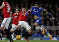 Manchester United's English defender Chris Smalling (L) clashes with Chelsea's Brazilian-born Spanish striker Diego Costa during the English Premier League football match between Chelsea and Manchester United at Stamford Bridge in London on February 7, 2016. / AFP / ADRIAN DENNIS / RESTRICTED TO EDITORIAL USE. No use with unauthorized audio, video, data, fixture lists, club/league logos or 'live' services. Online in-match use limited to 75 images, no video emulation. No use in betting…
