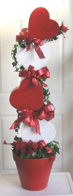 You can repaint some old heart-shaped boxes, stack and glue them together to create this great design for your home.
