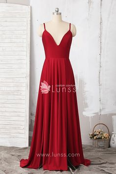 Simple and everlasting, this wine glossy jersey A-line dress features a delicate spaghetti strap V neckline with invisible zipper closure, and long skirt with high slit on left leg. It is a great piece for prom and other special occasion.