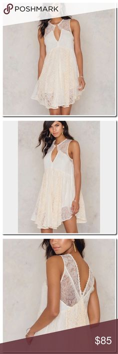 Free People Don't you Dare Dress Free People Everyone needs a little bit of lace in their wardrobe! The Don't You Dare Lurex Strapless Mini Dress by Free People comes in color natural combo and features sheer lace at bust, a wide fit, golden glitter details and two metal rings at front bust and center back for details. Style with heels for a romantic   Materials: Shell: 50% Cotton, 50% Nylon  Lining: 54% Rayon, 40% Nylon, 4% Polyester  The model is 180 cm and she is wearing size x-small (2)…