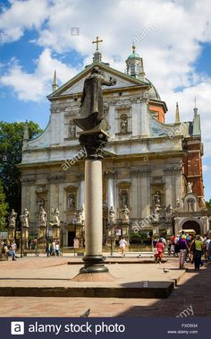 Tourists visiting historical plalces, St Peter and St Paul church, in Krakow, Poland Stock Photo