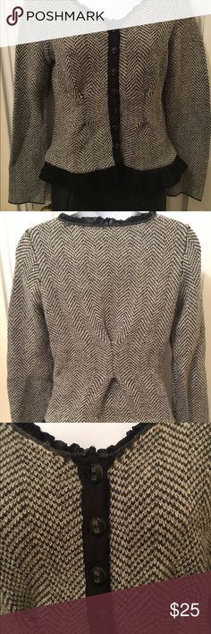 Peplum sweater with subtle ruffle neck and hem Beautiful peplum figure flattering sweater, with ruffled neck and hemline & button down detail. By Guinevere. Gently used, good condition. Anthropologie Sweaters Crew & Scoop Necks
