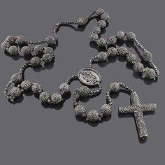 This Stunning Gold Black Diamond Rosary Necklace weighs approximately 113 grams and showcases carats of dazzling black diamonds. Featuring a luxurious design and a heavy black rhodium plating for an all-black look, this fantastic diamond rosary Diamond Chains For Men, Black Diamond Chain, Black Diamond Necklace, Diamond Cross Necklaces, Circle Pendant Necklace, Diamond Gemstone, Black Diamonds, Latest Jewellery Trends, Jewelry Trends