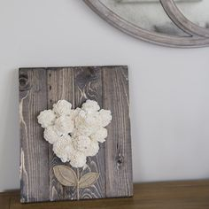 This romantic wood flower sign is handmade just for you! Made from sola wood, recycled pallet wood, and burlap.