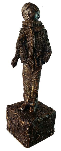 Small Boy, made with Powertex and Fabric painted with bronze tones.