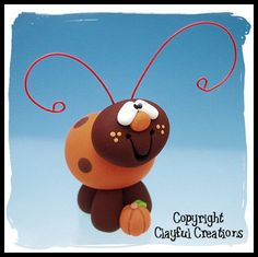 Ladybug Fun! This little Autumn Ladybug is ready to go home with you today! The ladybug and his pumpkin are hand sculpted from polymer clay and