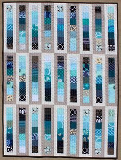 Teaginny Designs: Chance of Showers brilliant use of 2.5 inch squares, would also be good for jelly roll.