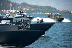 Sailors assigned to Coastal Riverine Squadron 4 and members of the Royal Malaysian navy conduct high value asset training during Cooperation Afloat Readiness and Training (CARAT) Malaysia 2015.