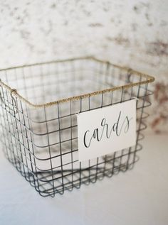 A wire basket and some gorgeous calligraphy is all you really need for a no-fuss card box.