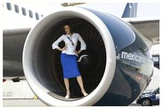 Miss Argentina 2007 poses in a Mexicana Airlines jet engine during a photo shoot in Mexico City for the Miss Universe pagant