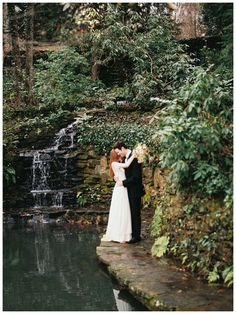 Bride and groom at the rock waterfall at Dunaway Gardens. Image by Simply Sarah Photography.