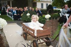 Cute flower girl wagon idea for rustic weddings!  Check out the burlap aisle runner, too. | http://emmalinebride.com/rustic/ways-use-burlap-weddings/