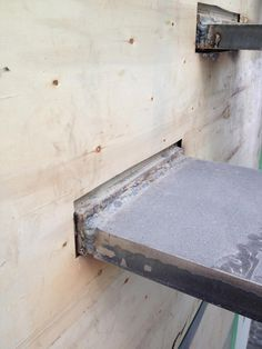 CANTILEVERED-STEEL-STAIR---SOLID-BAR-STEEL-TREADS-WELDED-TO-BASEPLATES