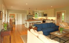 FARMHOUSE – INTERIOR – early american decor inside this vintage farmhouse living room seems perfect.
