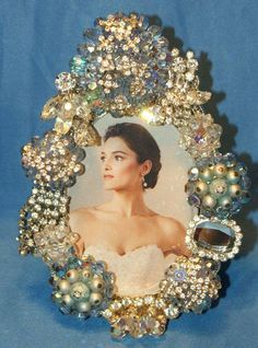 Use your broken costume jewelry to make a beautiful frame!!