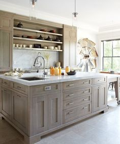 Photographer: Virginia Macdonald  Source: House & Home January 2012 issue  Products: Light fixtures (over island), Hardware Interiors; limestone floor, Saltillo Imports; cabinets, Cando Woodworking; Wolf stove, Tasco Distributors; sink, faucets, Ginger's.  Designer: Connie Braemer Design; architecture, Richard Wengle Architect; construction, G.E.S. Construction.like colour of the cabinets!