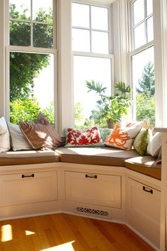sunny corner window seat in the kitchen, storage underneath, unobstructed view to the yard