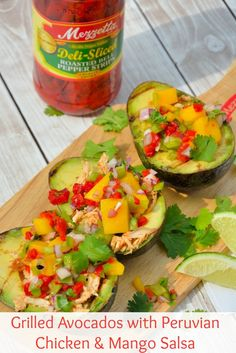 Grilled Avocados with Peruvian Chicken and Mango Salsa- spiced chilled chicken and sweet mango salad over creamy, hot avocados. Can you believe it only takes 15 minutes to prepare?? | #grilledavocados #bringtheheat | www.savoryexperiments.com