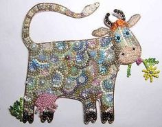 glamorous cow out of beads and wire