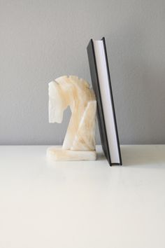 A personal favorite from my Etsy shop https://www.etsy.com/listing/235128927/horse-figurine-book-end-horse-statue