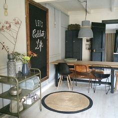 Love the table and the left chair. Love the jute rug and the black on wood pictu… - Esszimmer ideen Decor, Interior, House Styles, Home Decor, House Interior, Home Deco, Living Room Inspiration, Interior Design, Home And Living