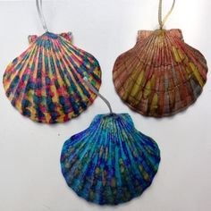 Natural scallop seashells from the beach Hand painted with inks sealed and then glittered These shell ornaments really sparkle The picture does not show the glitter very well but they