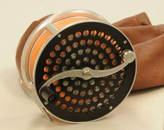 Peerless 4A Spey reel. This is a big one from Bob Corsetti. It has a lovely S shaped handle against highly perforated winding plate, but with a solid back plate. This reel has seen some use showing very light scuffs and nicks, but I would still rate it excellent. Comes in original 'Made in New England' leather bag.