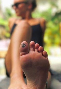 Foot Tattoos 58573 30 Hidden Tattoos Ideas to Satisfy Your Craving For New Ink Toe Tattoos, Mini Tattoos, Body Art Tattoos, Paw Print Tattoos, Tattoos For Pets, Cute Foot Tattoos, Cross Tattoos, Hair Tattoos, Tattoos On Girls