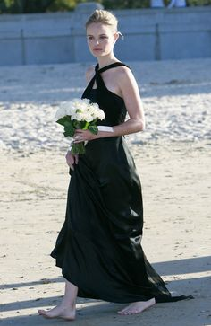 Kate Bosworth wore a Lisa Ho halter-neck bridesmaid dress to the  wedding of her friend Jackie Louez at Balmoral Beach in Sydney, Australia.