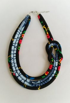 Multi strand African wax print necklace knotted at the side to create a trendy and fun statement piece which can be dressed up or down. - The necklace measures approximately 20 inches has a 2 inched inch extender chain for length adjustment. Please choose Diy African Jewelry, African Beads Necklace, African Accessories, Tassel Jewelry, Textile Jewelry, Fabric Jewelry, Ethnic Jewelry, Jewlery, Diy Necklace