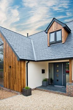 front door of Front exterior country contemporary house, with cedar claddin. Grey front door of Front exterior country contemporary house, with cedar claddin. Grey front door of Front exterior country contemporary house, with cedar claddin. House Cladding, Timber Cladding, Exterior Cladding, Cladding Ideas, Cladding Design, Wall Cladding, Grey Front Doors, Timber Front Door, Front Windows