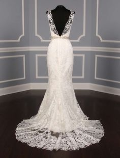 This 100% Authentic Romona Keveza RK5448 wedding dress is from the Luxe Collection. The Venetian lace is absolutely amazing in person and the embellished belt adds such elegance! This gown features a v-neck front and a v-back, both with scalloped edging detail. #romonakeveza