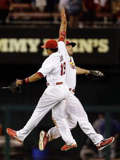 Jon Jay and Matt Holiday celebrate following the Cardinals' 3-2 victory over the Los Angeles Dodgers. 7-18-14
