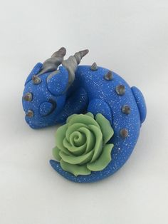 Handmade Polymer Clay Dragon Sleeping with a Rose by shopNoelled