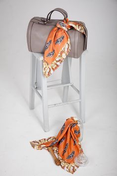 Styling Your Handbag  Why not try our Queen bee silk handkerchief scarf as an accessory to your handbag. The burnt orange colour is a key trend for this fall and very eye catching.   100% Silk - Made in Scotland with Pride Hand rolled edge - sewn by hand Digitally printed   http://www.heathermargaretgrace.co.uk/shop/silkbee