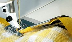 To bind edges with 1/2 (12 mm) Bias Binding, cut a 2 (50 mm) wide bias strip of light weight fabric, or use packaged extra wide double fold Bias Binding. Straight stitch, length 2.5, or zigzag or decorative stitch at desired length.