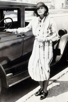 Greta Garbo looks chic in a striped shirt dress in 1932. // #Fashion